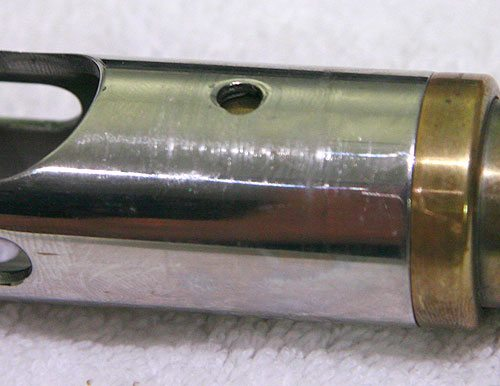 circle snub brass cocker barrel top close up