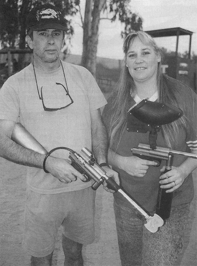 Rick, left, and Lori, right, with their Palmer's Pursuit Shop Blazers, scanned from APG, July, 1997.