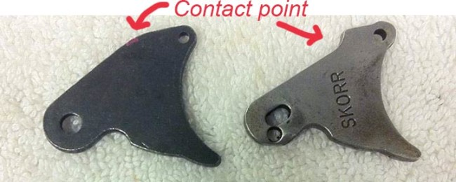 Rounded nelspot 007 trigger plate and a Skorr trigger plate