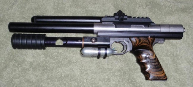 Automag pistol with the pump 12 gram changer left side.