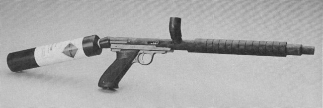 """Close up of the ad scanned from the Spring 1989 issue of """"Paintball"""" magazine, which shows the J.A.S. Heckman Competition Brass Bore drop model."""