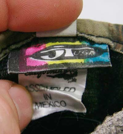 The tag off a neat pair of 90s era JT camo gloves.