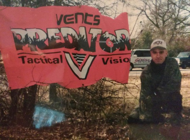 Joe Gorscos next to Vents Predator banner.