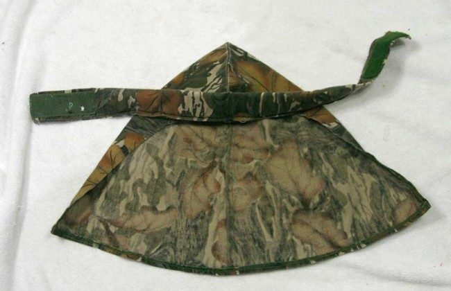 A Mossy Oak head wrap which was likely made by Tim Schloss at Tiger Stripe Products.
