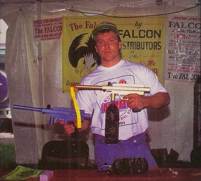 Rob Fox, of Paintball Heaven and Falcon Inc. Rob is holding the Blue and Yellow Falcons. Scanned from a photo printed in the February 1995 issue of PSI.