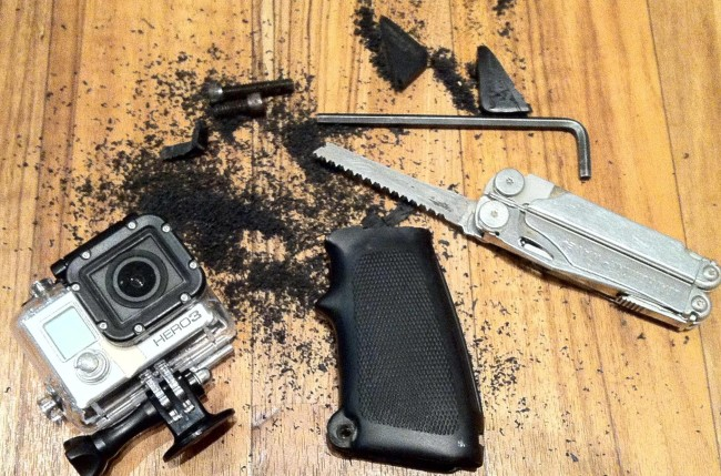 Cut up m-16 lone star grip adapter to hold a Go Pro securely.