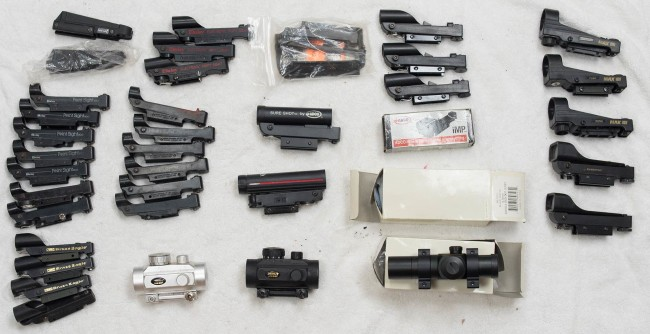 A large selection of working and broken daisy point sights.