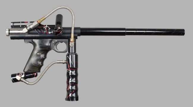Right side of Black, red white splash automag.