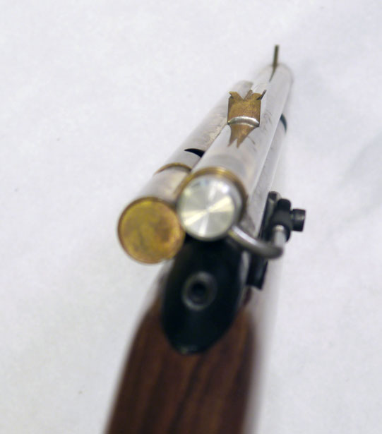 Back view of Thadapter and Rifle.