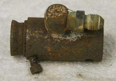 Left side view of a stock 007 nelspot in grip valve that has had the piercer hole plugged and a side tap added.