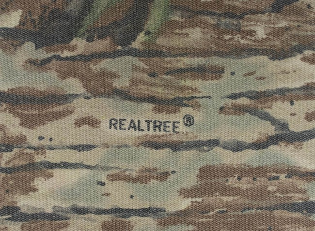 """Realtree®"" logo incorporated into camouflage of pullover."