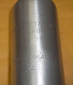 Polished 10oz tank exterior reveals date of 8-1987.