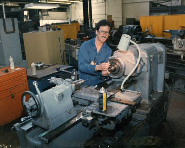 """Rick on a Monarch Lathe at the Concord Naval Weapons Station in the early 1990s. He writes, """"My favorite machine, the Monarch Lathe."""" Photo courtesy Rick Cendejas."""