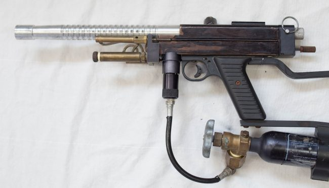 Right side view of this Autococking Sniper 1. No inline High Pressure Regulator was used on these early models and the co2 was directed from the tank directly into the vertical asa through a plastic coated line.