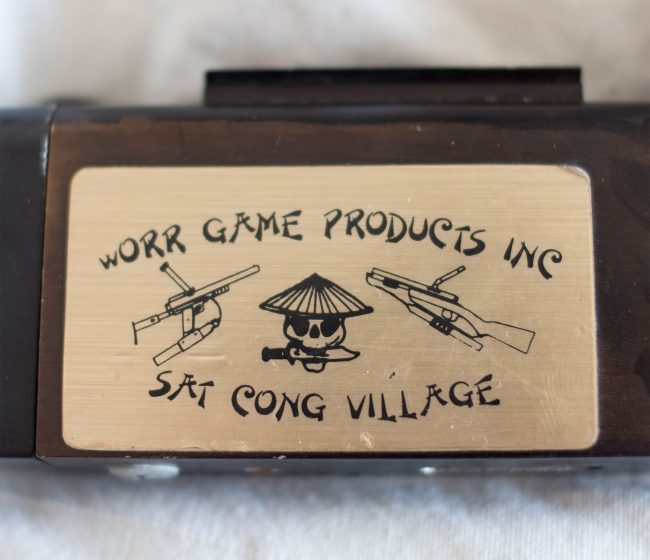 Close up on Sat Cong Village and Worr Game Products Inc. Sticker.