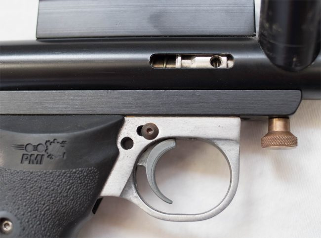 Close up of right side of pinned trigger slide frame to operate as a swing.